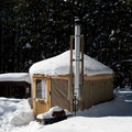 Yurt deep in the snowy forest.- Arizona Nordic Village Cabins + Yurts