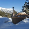 View of the San Francisco Peaks from a backcountry yurt.- Arizona Nordic Village Cabins + Yurts