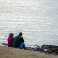 A couple relaxes on the hike.- Lopez Island: Iceberg Point