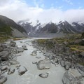 The silty water of the Hooker River. Mueller Lake and Mueller Glacier is in the center, and the glacier looks more like a rockfall.- Hooker Valley Track