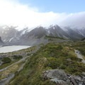 A viewpoint with a view of Mueller Lake, Mueller Glacier, and the trail.- Hooker Valley Track