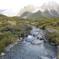 A stream in the grasslands between the second and third suspension bridges.- Hooker Valley Track