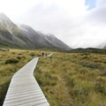Walking into the Hooker Valley. Aoraki/Mount Cook (3,724 m) would dominate the view from here on a clear day.- Hooker Valley Track