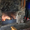 Main room and fireplace at the Tilly Jane Guard Station.- Tilly Jane Guard Station