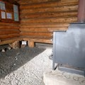 Nordeen Shelter has a wood stove and a stockpile of wood.- Nordeen Shelter via Snowshoe Long Loop