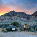 Las Vegas sunset over Red Rock at the First Creek Trailhead.- First Creek Pool + Waterfall