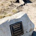 Sassafras Mountain summit marker on the border between South Carolina and North Carolina.- Sassafras Mountain