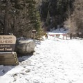 Trailhead and the closed parking lot gate for Lake Blanche and Broad's Fork.- Lake Blanche Snowshoe