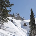 Sundial Peak popping out above the saddle.- Lake Blanche Snowshoe