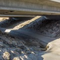 The trail runs under some bridges.- Serrano Creek Trail