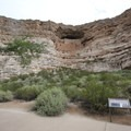 Interpretive signs with Montezuma Castle in the background.- Montezuma Castle National Monument
