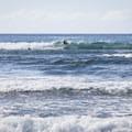 Surfers on the break off of Kahalu'u Beach.- Kahalu'u Beach