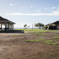 Covered picnic areas and restrooms at Old Kona Airport Beach Park.- Old Kona Airport Beach Park