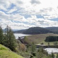 View of Dorena Dam from the Row River Trail.- Row River National Recreation Trail