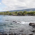 The rocky ledge makes for an easy entry for snorkelers.- Pae'a / Two Step at Hōnaunau Bay