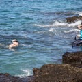 The rock ledge at Two Step makes for easy entrance and exit.- Pae'a / Two Step at Hōnaunau Bay