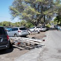 Roadside parking fills up early in the day.- Pae'a / Two Step at Hōnaunau Bay