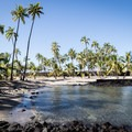 The protected bay at Pu'uhonua o Hōnaunau National Historical Park. Swimming is prohibited here, and the beach is a common resting place for sea turtles.- Pu'uhonua O Hōnaunau National Historical Park