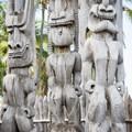 Statues guard the Hale o Keawe, the royal mausoleum.- Pu'uhonua O Hōnaunau National Historical Park