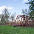 The former steel railroad bridge is now a footbridge for the Row River Trail.- Mosby Creek Trailhead