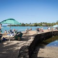 The retaining wall that forms the backbone of the beach and the Ku'u Ali'i fishpond.- 'Anaeho'omalu Bay / A-Bay Beach