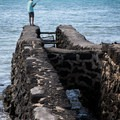 The gate that allows fish to swim into the Ku'u Ali'i fishpond.- 'Anaeho'omalu Bay / A-Bay Beach