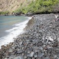 The rocky shore makes water footwear a must.- Kealakekua Bay State Historical Park