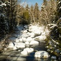 Crossing the MacIntyre Brook.- Table Top Mountain Snowshoe