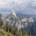 Half Dome, Clouds Rest, Mount Broderick, Liberty Cap, Nevada Fall (from left to right).- Panorama Trail