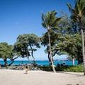 The grassy area at Kikaua Point.- Kikaua Point Park + Beach