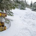 Deep snow at the junction between the Elk Pass Trail and the Nippletop spur trail.- Nippletop + Dial Mountains