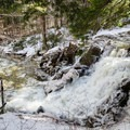 Gill Brook was raging because of a recent thaw and rain.- Nippletop + Dial Mountains