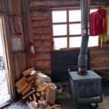 The inside of Maiden Peak Cabin.- Maiden Peak Cabin Snowshoe via Gold Lake Sno-Park