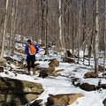 As the snow melts, you can hike with light traction.- Camels Hump Via The Burrows Trail