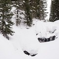 The snow-covered falls dressed in a big snow year.- Secret Falls Snowshoe