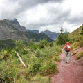 Hiking toward Ptarmigan Tunnel in Glacier National Park.- Ptarmigan Tunnel Hike via Lake Elizabeth Foot Campground