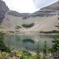 Ptarmigan Lake in Glacier National Park.- Ptarmigan Tunnel Hike via Lake Elizabeth Foot Campground