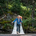 A suspension bridge on the Ptarmigan Tunnel Hike. - Ptarmigan Tunnel Hike via Lake Elizabeth Foot Campground