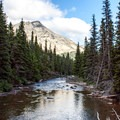 Fresh glacier streams in Glacier National Park.- Ptarmigan Tunnel Hike via Lake Elizabeth Foot Campground