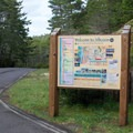 The Siltcoos Access Road information sign.- Lagoon Campground
