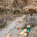 The Lost Creek Canyon Trail begins in the center of the parking area.- Lost Creek Canyon Falls