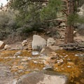 A seasonal creek flow may require some rock-hopping to cross.- Lost Creek Canyon Falls