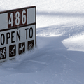 Trail use sign buried in the snow.- Hahns Peak Lake Area