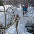 Use caution while crossing the snow bridge.- Lee Vining Ice Climbing Area