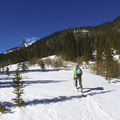 Backcountry skiiers making their way to steeper terrain.- Crater Lakes via East Portal Trailhead