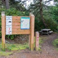 Information sign at the Stagecoach Trailhead parking area.- Chief Tsiltcoos Trail