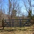 Park near this gate.- Big Creek Cave Falls