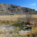 The pool sits in the canyon bottom nearby the Walker River.- Walker Warm Springs