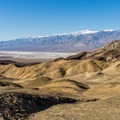 The Artist's Palette hills backed by the Panamint Mountains.- Desolation Canyon Hike