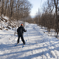 Cross-country skiing down the wide path.- Overlook Mountain